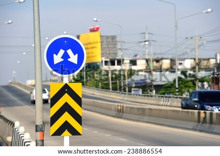 Fork in the road sign - stock photo