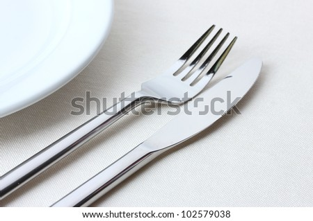 fork, knife and plate isolated on white