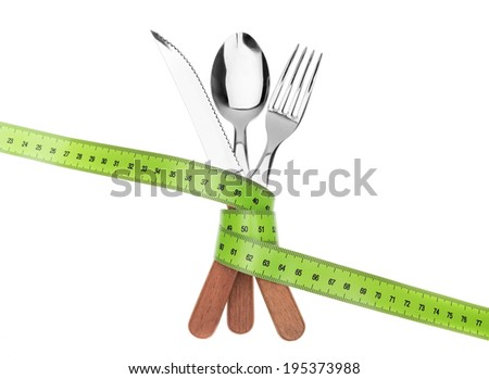 Fork knife and spoon in a tape meter. To measure the diet. - stock photo