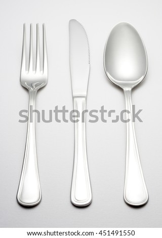 Fork, spoon and knife - stock photo