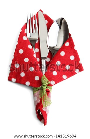 Fork spoon and knife in napkin isolated on white - stock photo