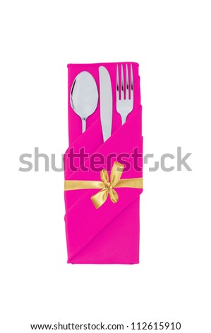 Fork, spoon and knife in pink cloth with golden bow isolated on white background - stock photo