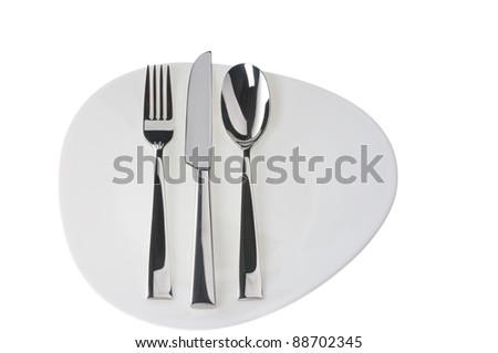 Fork, spoon and  knife on a plate over white background