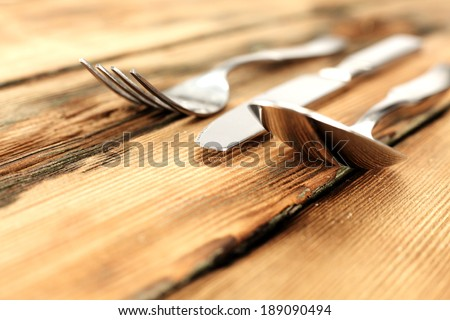 fork spoon knife and desk  - stock photo
