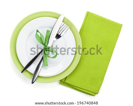 Fork with knife over towel and empty plates. Isolated on white background - stock photo