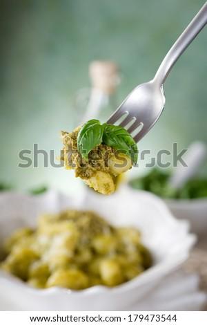fork with pesto gnocchi - stock photo