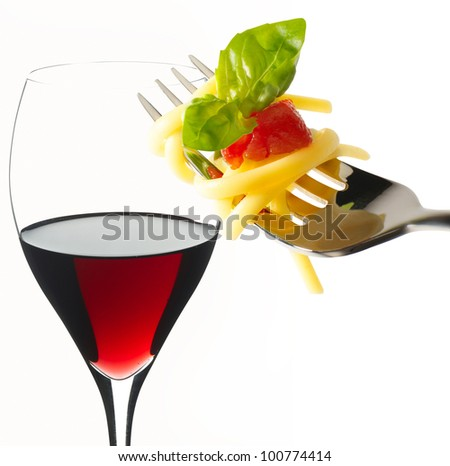 fork with spaghetti and red wine glass