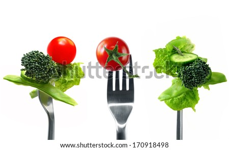 Forkfuls of healthy food over white background.