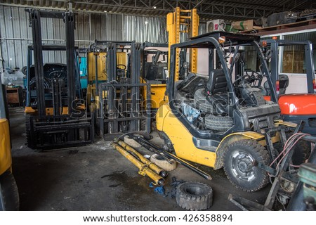 Forklift garage with parts  - stock photo