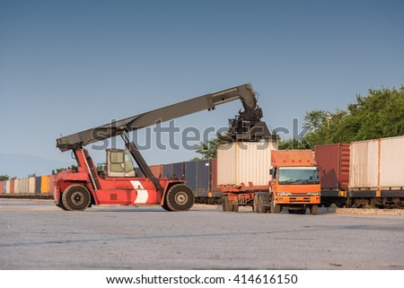 Forklift handling container box loading at the Docks to Truck - stock photo