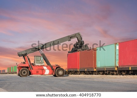 Forklift handling container box loading at the Docks with Truck