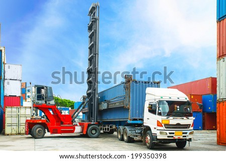 forklift handling  container box loading to truck in container depot - stock photo