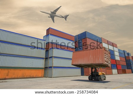 Forklift handling container box loading to truck in import export logustic zone - stock photo