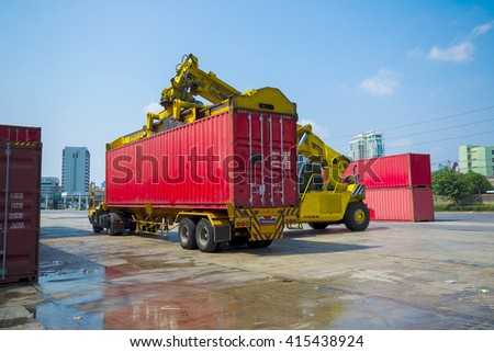 forklift handling container loading box from freight train to the truck