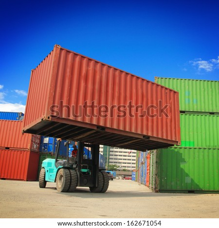 forklift handling the container box - stock photo