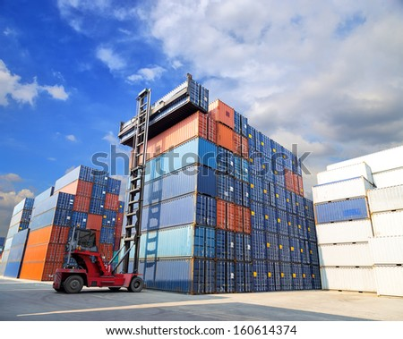 forklift handling the container box at dockyard - stock photo