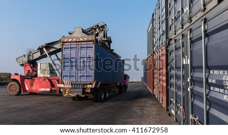 Forklift handling the containers box in the port at Thailand - stock photo