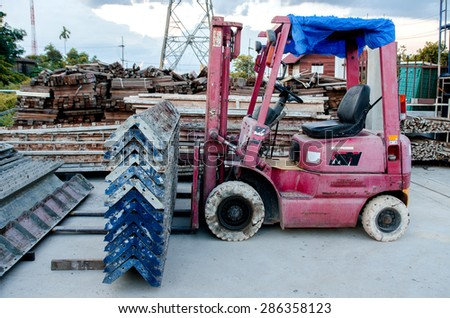 Forklift in warehouse with many boxes on pallet