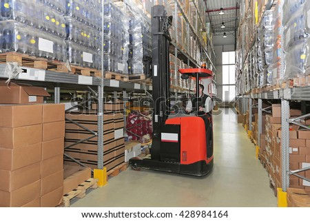 Forklift Loading Pallet With Goods in Distribution Warehouse