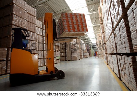 Forklift operating in Warehouse