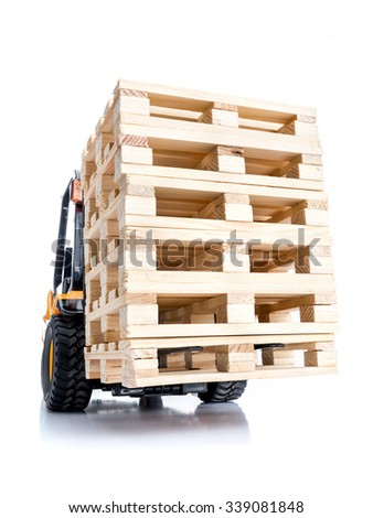 Forklift truck carrying stacked wooden pallets shot on white background - stock photo