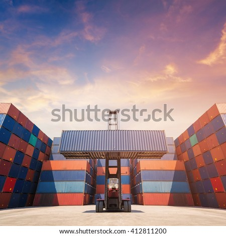 Forklift truck lifting cargo container in shipping yard for transportation import,export, logistic industrial with container stack in background - stock photo