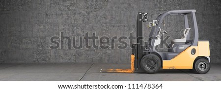 Forklift truck on industrial dirty wall background - stock photo