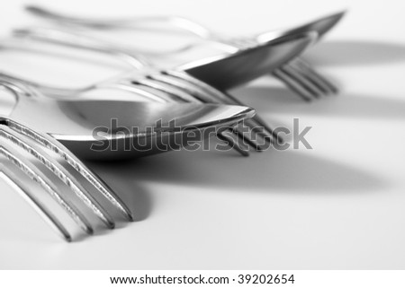 forks and spoons on a white table