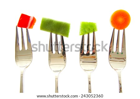 Forks with vegetables. Red and green pepper, beans and carrot isolated on white background - stock photo