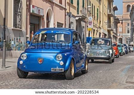 """FORLI', ITALY - JUNE 8: unidentified crew on a blue vintage Fiat 500 Abarth leads a line of italian mini cars during the rally """"Emozioni 500""""  on June 8, 2014 in Forli', Italy  - stock photo"""