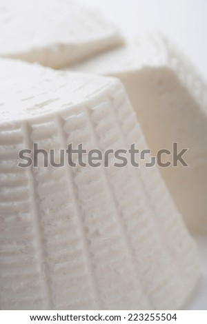 Form of fresh ricotta with fresh ricotta cheese slice cut shape with slice cut out - stock photo