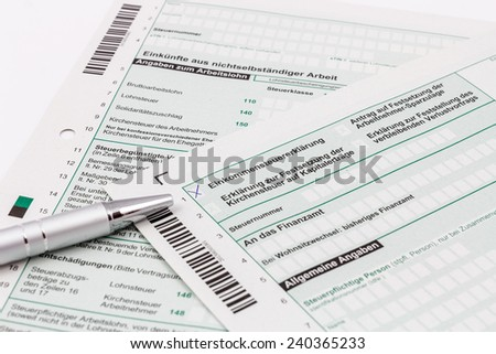 Form of income tax return with ball pen