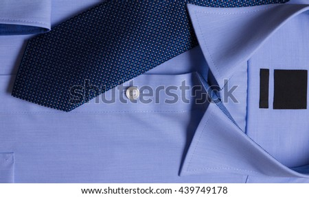 formal blue shirt and necktie - stock photo