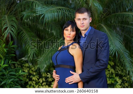 Formal couple posing for a portrait - stock photo