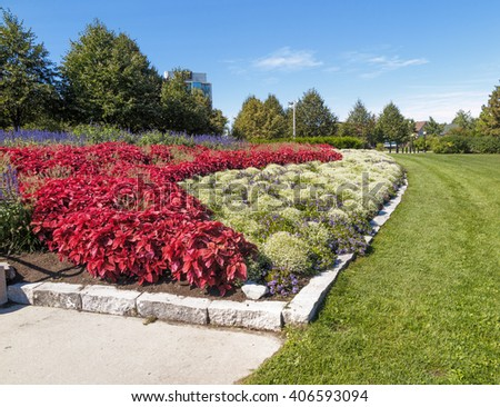 Formal flower beds in park - stock photo