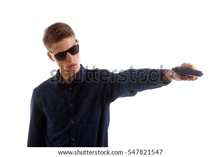Formal man with a gun