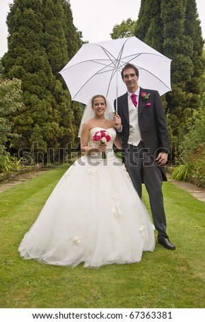 Formal portrait of young attractive bride and groom