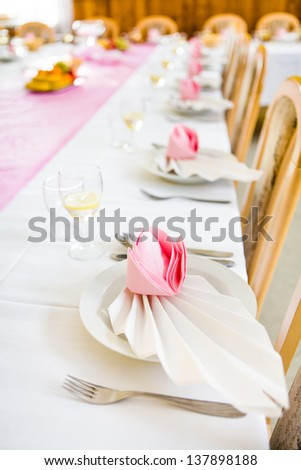 Formal table with napkins ready for meal serving, shallow dof - stock photo