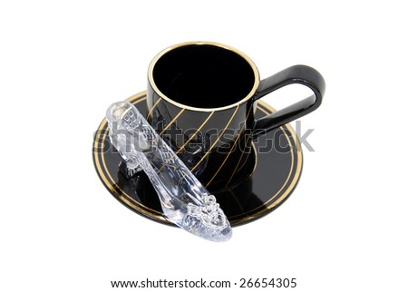 Formal tea cups with a delicate china pattern for drinking tea with a side of crystal slipper for fashion statement-Path orig size - stock photo
