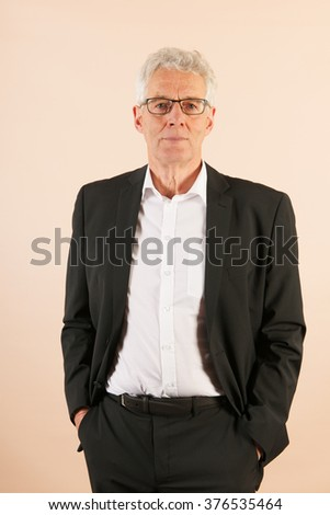 Formally dressed senior man with gray hair - stock photo
