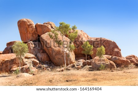 formation of round boulders in Central Australia called Devils Marbles - stock photo