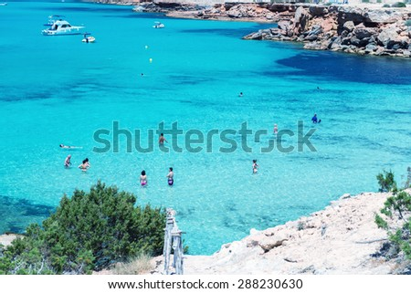 FORMENTERA, SPAIN - JUNE 4, 2015: Cala Saona Beach with tourists. Formentera is a very famous tourist attraction. - stock photo
