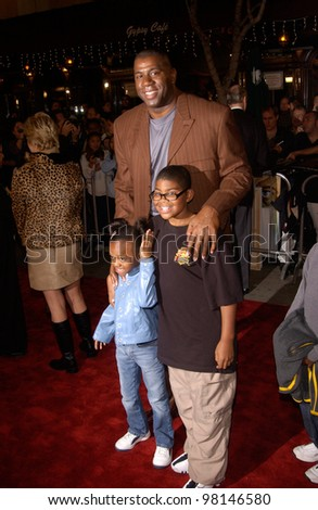 Former basketball star EARVIN MAGIC JOHNSON & family at the Los Angeles premiere of Harry Potter and the Sorcerer's Stone. 14NOV2001.   Paul Smith/Featureflash - stock photo