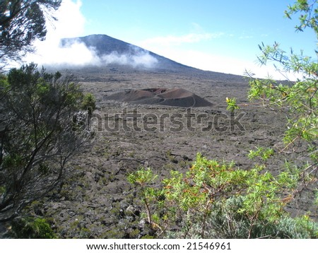 Formica Leo and Fournaise volcanoes in Reunion Island with a patch of fog in the background - stock photo