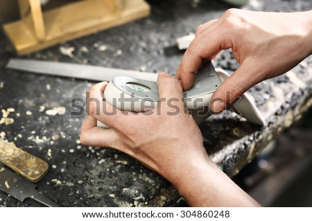Forming shoes, classic elegance sewn with a cobbler.Shoemaker sews shoes - stock photo