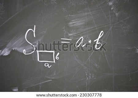 formula of rectangle area written on school blackboard closeup - stock photo