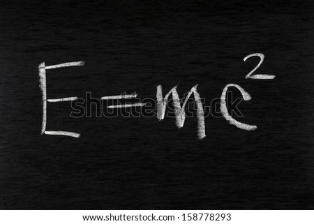 Formula of the law of conservation of energy written by chalk on a blackboard
