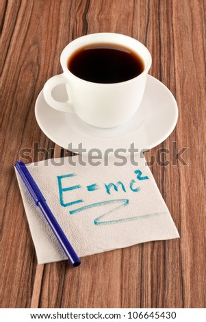 Formula on a napkin and cup of coffee - stock photo