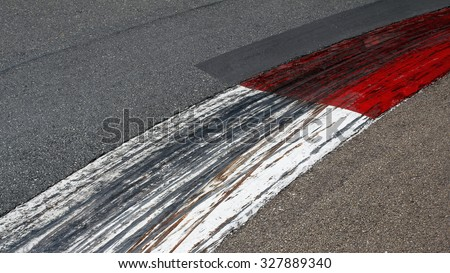 Formula 1 tire marks on painted kerb at race track. Close up on Monaco Montecarlo Grand Prix street circuit - stock photo
