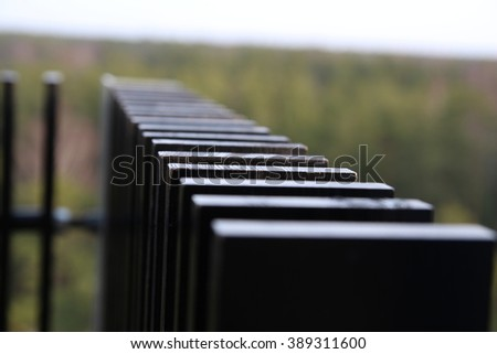 Forrest of green pine trees from bird's-eye view. Watchtower - stock photo